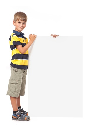 Boy holding a banner isolated on white background. Back to school photo