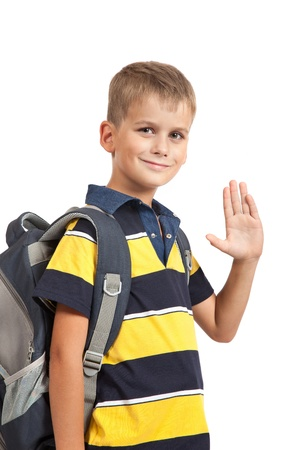 hi: Schoolboy sitting on books isolated on a white background. Back to school