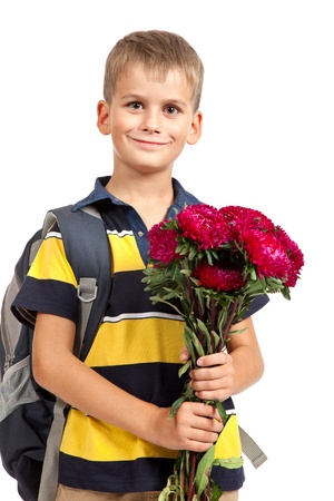 Handsome little schoolboy is holding flowers isolated on white background. Back to school Stock Photo - 14736715