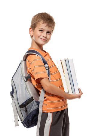 Boy holding books isolated on a white background. Back to school Stock Photo - 14736714