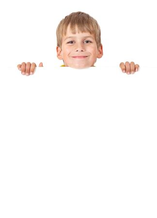 Boy holding a banner isolated on white background Stock Photo - 14736712