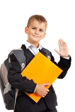 Schoolboy with book isolated on a white background photo