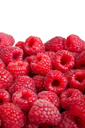 solated: Background of ripe red raspberries. �solated on white