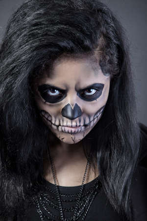 Young woman in day of the dead mask skull face art. Halloween face art with fog on black background Stock Photo - 15237990