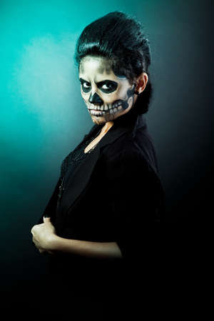 Young woman in day of the dead mask skull face art. Halloween face art with fog on black background Stock Photo - 15441048
