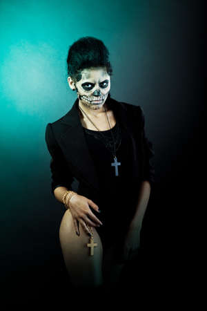 Young woman in day of the dead mask skull face art. Halloween face art with fog on black background Stock Photo - 15441044