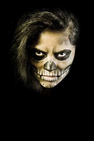 Young woman in day of the dead mask skull face art. Halloween face art with fog on black background Stock Photo - 15441042
