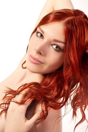 Portrait of young woman with red hair isolated on a white background photo