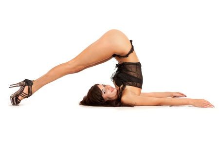 Sexy woman practicing yoga. Wears beautiful shoes isolated on a white background photo