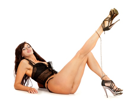 Sexy woman. Legs in chains - isolated on white photo