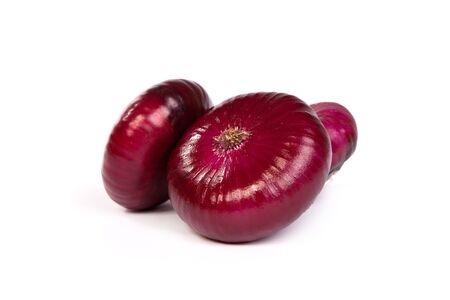 pealing: Group of a red onions, isolated against white background Stock Photo