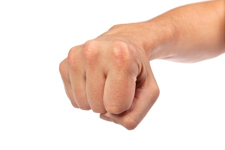 Hand with clenched a fist, isolated on a white background photo