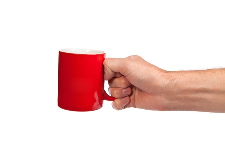 Male hand is holding a red cup isolated on a white background photo