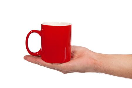Male hand is holding a red cup isolated on a white background Stock Photo - 15767051