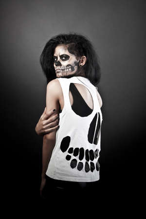 Young woman in day of the dead mask skull face art. Halloween face art with fog on black background Stock Photo - 15920600