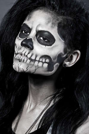 Young woman in day of the dead mask skull face art. Halloween face art with fog on black background Stock Photo - 16037034