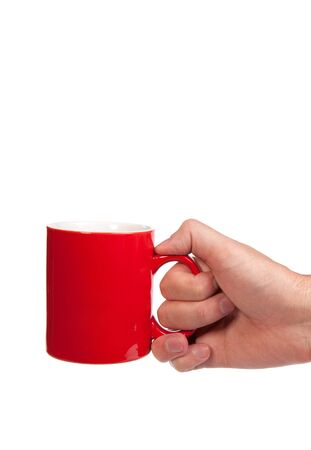 Male hand is holding a red cup isolated on a white background Stock Photo - 17634473
