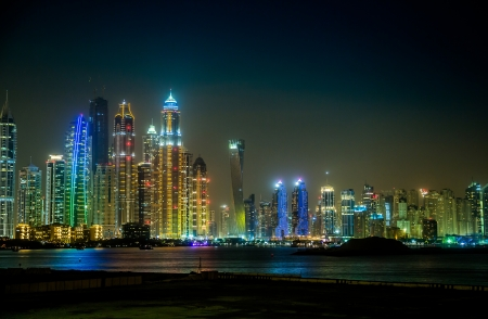 DUBAI, UAE - NOVEMBER 13: Dubai downtown night scene with city lights, luxury new high tech town in middle East, United Arab Emirates architecture. Dubai Marina cityscape, UAE photo