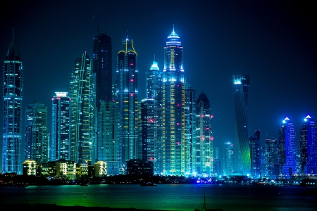 bay: DUBAI, UAE - NOVEMBER 13: Dubai downtown night scene with city lights, luxury new high tech town in middle East, United Arab Emirates architecture. Dubai Marina cityscape, UAE