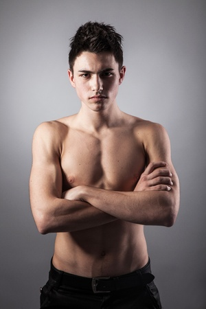 bodybuilding boy: Portrait of young bodybuilder man on a black background Stock Photo