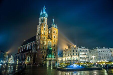 Krakow old city at night St. Marys Church at night. Krakow Poland. photo
