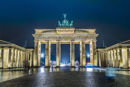 BRANDENBURG GATE, Berlin, Germany at night. Road side view photo
