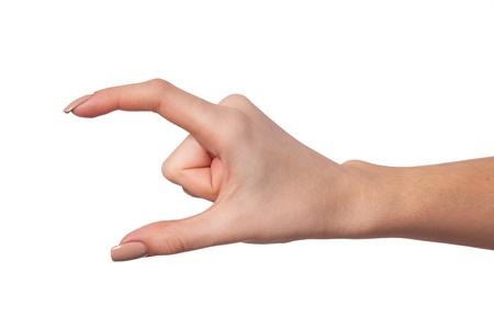 Dobře tvarovaný Ženská ruka sahá po něčem na bílém pozadí Reklamní fotografie