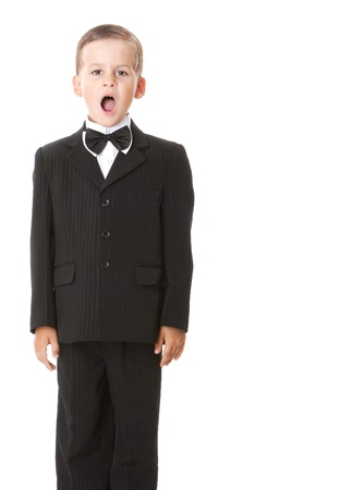 Boy in a suit singing. Shot in studio photo