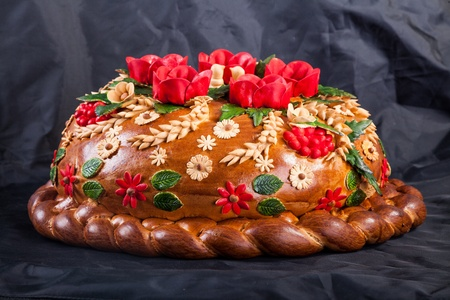 Ukrainian festive bakery Holiday Bread isolated on a black background photo