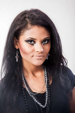 pierced ears: Beautiful woman. Fashion portrait. Close-up face makeup. Black hair young woman portrait, studio shot