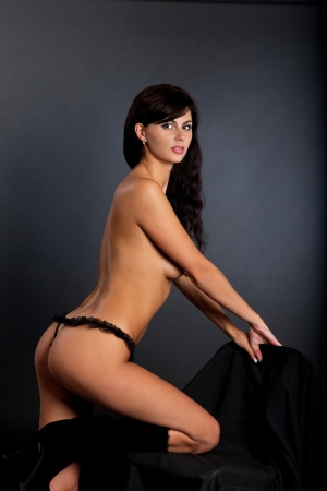 Sexy nude woman isolated in a black background photo