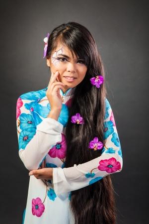 Beautiful fantasy eye face-art close-up portrait of a beautiful asian womanl photo
