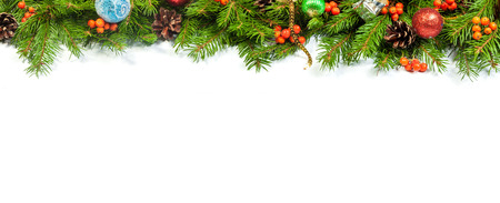 candy border: Christmas background with balls and decorations isolated on white background Stock Photo