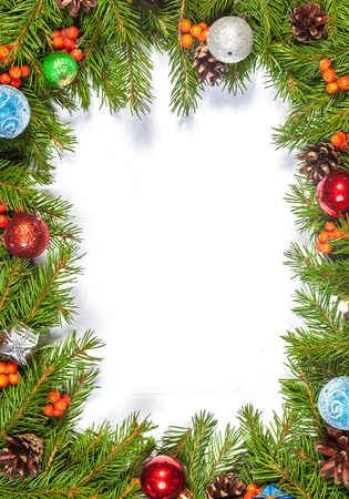 christmas fir: Christmas background with balls and decorations isolated on white background Stock Photo
