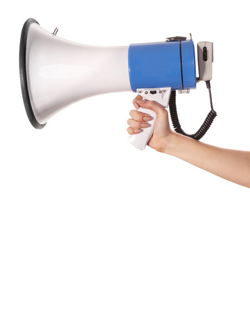 Female hand holding a megaphone. Isolated on a white background photo