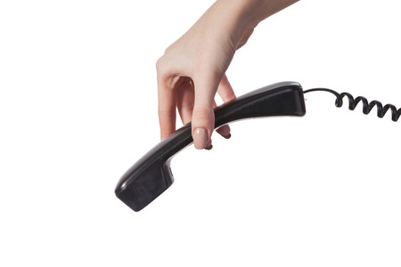 Hand holding an old black telephone tube isolated on white background Stock Photo - 22199947