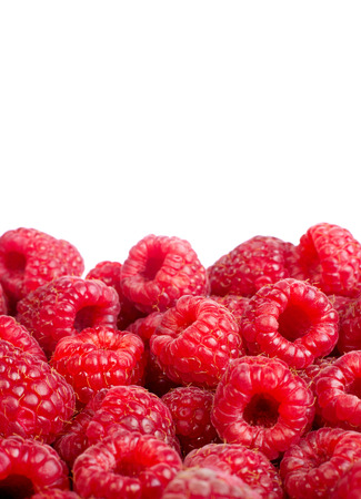 Background of ripe red raspberries  Іsolated on white photo