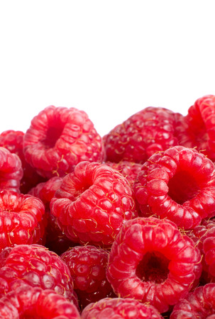 solated: Background of ripe red raspberries. Іsolated on white