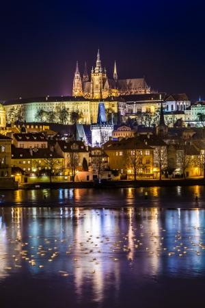 The View on Prague gothic Castle with Charles Bridge in the Night, Czech Republic photo