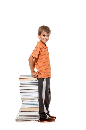 Boy and books isolated on a white background photo