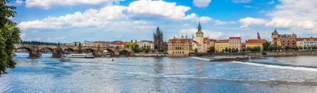 Cityscape of Prague. Panoramic view of Karlov or charles bridge and river Vltava in Prague in summer photo
