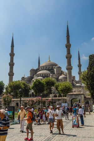 ISTANBUL - AUGUST 7: People visiting square near Sultan Ahmed Mosque, August 7, 2013 in Istanbul, Turkey. Sultan Ahmed Mosque (Blue Mosque) on of most popular tourist attractions in Istanbul.