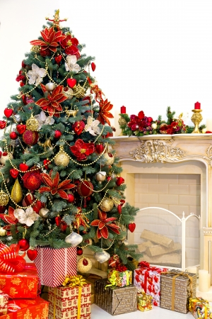 Decorated Christmas tree and gift boxes in living room photo