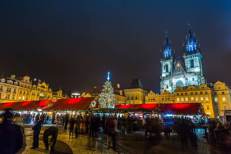 PRAGUE, CZECH REPUBLIC - DEC 17: Group of people enjoy Christmas market in Prague on December 17, 2012 in Prague. It attracts more than 750 thousands of visitors during the whole advent time.