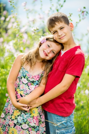 Portrait of a cheerful girl and boy hugging fun in outdoor Stock Photo - 24186909