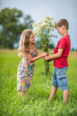 couple in love, boy gives a girl a bouquet of wild flowers