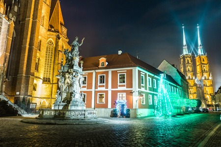 Church and monument at night in Wroclaw, Poland photo