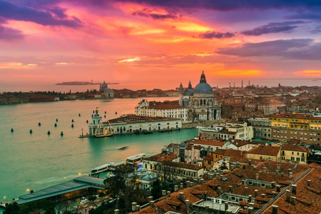 View of Basilica di Santa Maria della Salute at night under very dramatic sunset,Venice, Italy photo