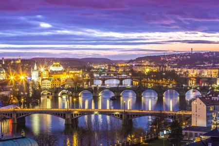 View at The Charles Bridge and Vltava river in Prague in dusk at sunset photo