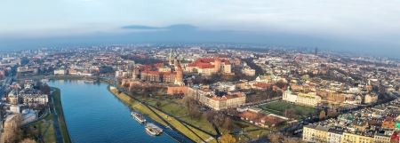 Historic royal Wawel castle in Cracow, Poland with park and Vistula river. Aerial view at sunset. photo